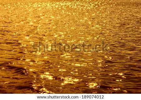 Liquid golden background - stock photo