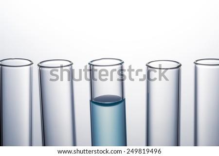 liquid in test tube, laboratory glassware - stock photo