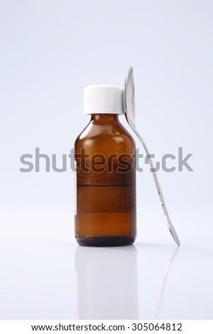 liquid medicine in the brown bottle - stock photo
