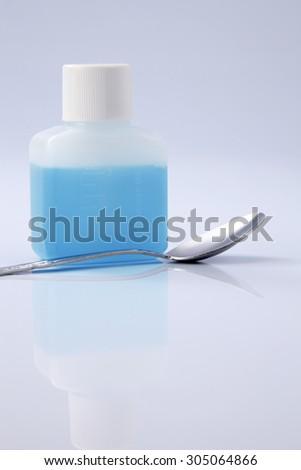 liquid medicine in the plastic bottle - stock photo