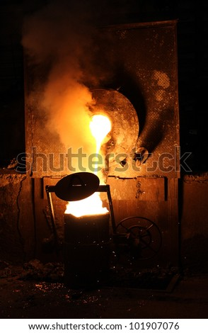 Liquid metal from casting ladle  Ferrous metallurgy - stock photo