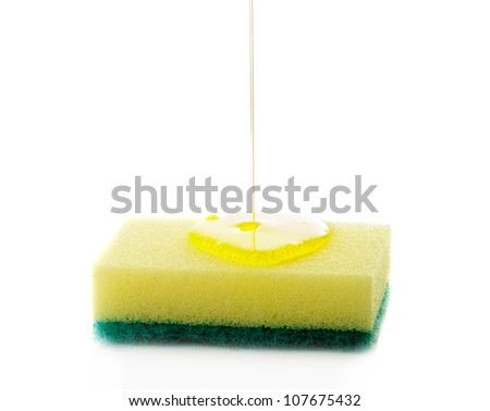 Liquid soap being poured on a dish sponge. - stock photo
