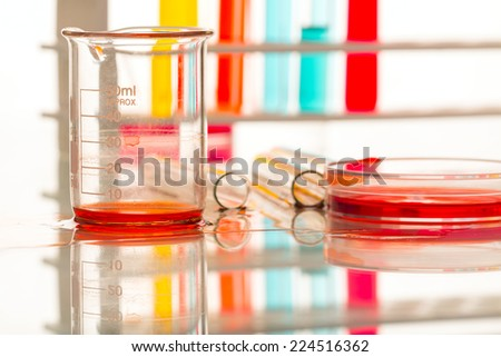 liquid spilled from laboratory glassware  - stock photo