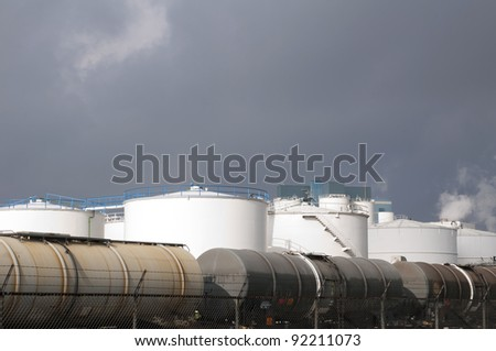 liquid train wagons and oil and fuel storage tanks - stock photo