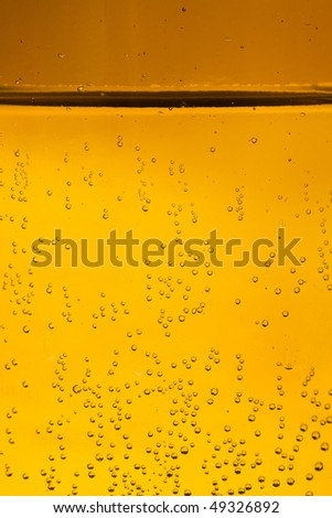 liquid with bubbles macro surface  - stock photo