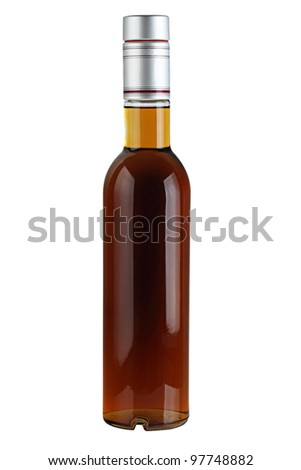 Liquor in a glass bottle isolated on a white background. - stock photo