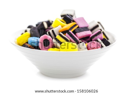 liquorice allsorts in a bowl isolated on a white background - stock photo