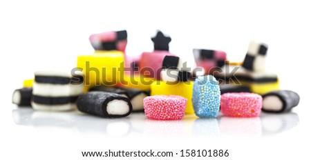 liquorice allsorts isolated on a white background - stock photo