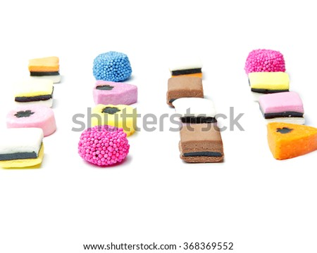 liquorice candy made of different bright colours on a white background - stock photo