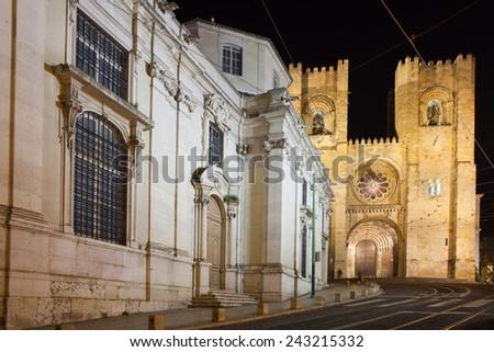 Lisbon Cathedral (Portuguese: Santa Maria Maior de Lisboa) at night in Portugal. - stock photo
