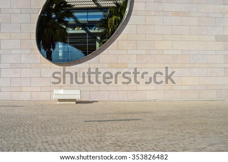 LISBON - DECEMBER 20: Modern building facade with large elliptical window, Champalimaud Centre for the Unknown in Belem, Lisbon, Portugal on December 20, 2015
