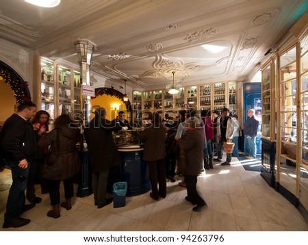 LISBON - DECEMBER 31: Tourist ordering the Pasteis de Belem at the Famous Belem Lisbon Cafe, a symbol of Lisbon, on December 31, 2010 in Lisbon, Portugal - stock photo