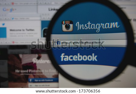 LISBON - JANUARY 29, 2014: Photo of Instagram and Facebook homepage on a monitor screen through a magnifying glass among other popular social networking sites. - stock photo