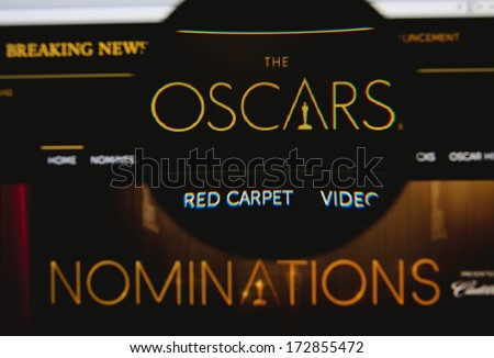 LISBON - JANUARY 23, 2014: Photo of the Academy Awards homepage on a monitor screen through a magnifying glass. - stock photo