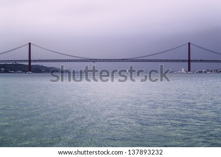 Lisbon. November 2012. 25 April Bridge, built in 1966 by United Stated Steel Export Company, connects the two sides of Tagus Estuary, LIsbon with Almada. - stock photo