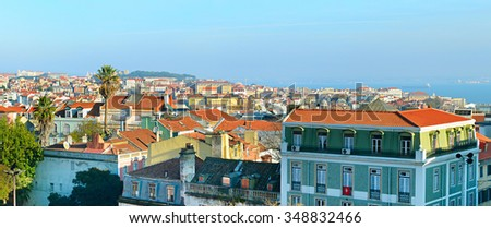 Lisbon panoramic view with typical portuguese buildings on foreground.Portugal - stock photo