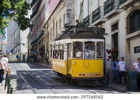 LISBON - PORTUGAL, April 29, 2014: A traditional form of public transport in Lisbon is the tram. Introduced in the 19th century, the trams were originally imported from the USA. - stock photo
