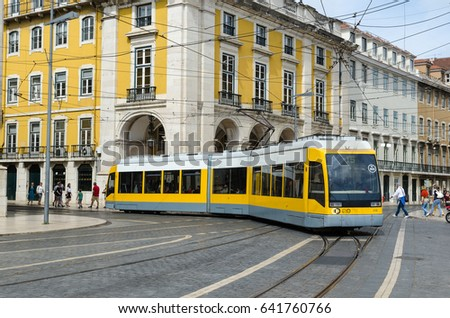 LISBON, PORTUGAL - APRIL 25: New and modern tram arrives at the square Praca do Comercio in Lisbon, Portugal on April 25, 2017
