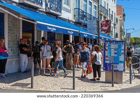 Lisbon, Portugal. August 24, 2014: The famous Pasteis de Belem - Egg Custard Tart - pastry shop in Lisbon. Clients wait on the street as the shop is always full. Over 20.000 tarts are sold daily. - stock photo