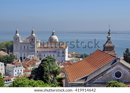 LISBON, PORTUGAL - CIRCA SEPTEMBER 2012: Domes of the National Pantheon and the Church of Sao Vicente of For a with the Tagus River in the background