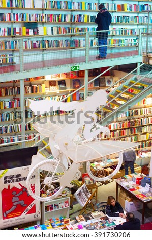 LISBON, PORTUGAL - DECEMBER 21, 2014: People at a bookstore in Lisbon. Lisbon is the capital of Portugal - stock photo