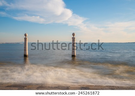 Lisbon, Portugal, Europe - View of the wharf columns in square of commerce (afternoon, long exposure) - stock photo