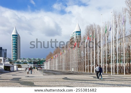 Lisbon, Portugal - February 01, 2015: Flags of all countries of the world in Rossio dos Olivais (Olive Grove Square). Parque das Nacoes (Park of Nations). Sao Gabriel Tower and Vasco da Gama Mall - stock photo