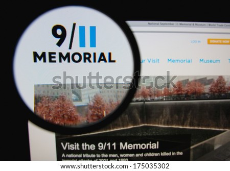 LISBON, PORTUGAL - FEBRUARY 5, 2014: Photo of 9/11 Memorial homepage on a monitor screen through a magnifying glass. - stock photo