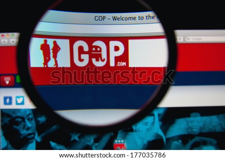 LISBON, PORTUGAL - FEBRUARY 17, 2014: Photo of the GOP homepage on a monitor screen through a magnifying glass. - stock photo
