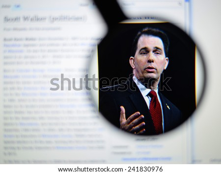 LISBON, PORTUGAL - January 4, 2015: Photo of Wikipedia article page about Scott Walker on a monitor screen through a magnifying glass.    - stock photo