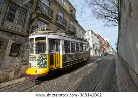LISBON, PORTUGAL - JANUARY 23: Traditional tram on January 23, 2016 in Lisbon, Portugal. The Lisbon tramway network operates since 1873.