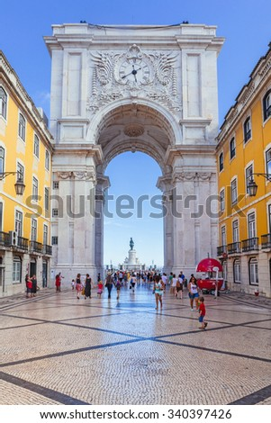 Lisbon, Portugal - July 24, 2015: Looking through the Rua Augusta Arch at the statue in the middle of Lisbon Commerce square - Praca do Comercio in Lisbon, Portugal. - stock photo