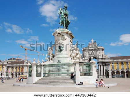 LISBON, PORTUGAL - JULY 7, 2011 - Triumphal Arch and King Jose I bronze statue in the   Commerce Square in the very center of Lisbon, Portugal