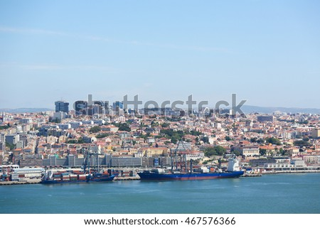 LISBON, PORTUGAL - JULY 11, 2016: View on container ships at the Port of Lisbon at the river Tagus in Portugal