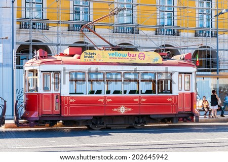 LISBON, PORTUGAL - JUN 20, 2014:  Electric tramway on the Commerce Square (Praca do Comercio) in Lisbon, Portugal. The Square was destoryed by the 1755 Lisbon Earthquake and then it was reconstructed