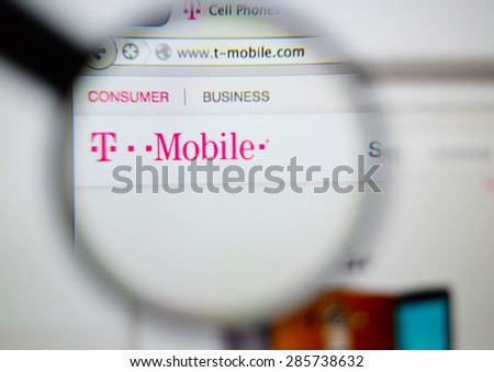 LISBON, PORTUGAL - June 6, 2015: Photo of: www.t-mobile.com,  homepage on a monitor screen through a magnifying glass. - stock photo