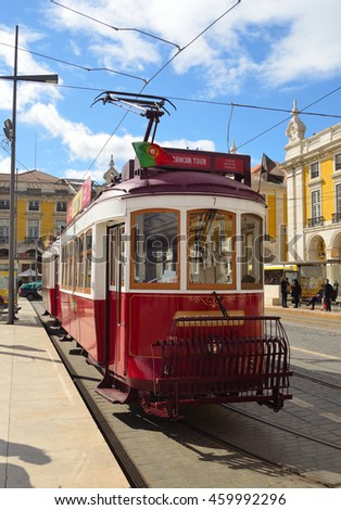 LISBON, PORTUGAL - MARCH 06, 2016: Vintage Tourist Sightseeing  Tram on the Praca do Comercio  Lisbon Portugal.