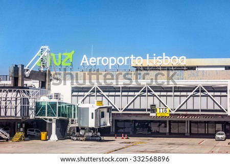 Lisbon, Portugal - May 30, 2013: At the airport of lisbon (Aeroporto Lisboa) after landing. Main gate with tower. - stock photo