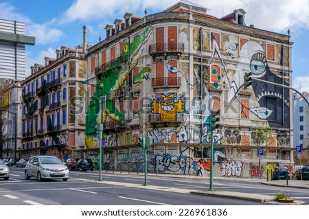LISBON, PORTUGAL - MAY 2, 2012 - The old abandoned house, located on Avenida Fontes Pereira de Melo with big green crocodile painted on it, on May 2 in Lisbon. - stock photo