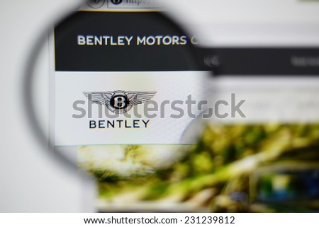 LISBON, PORTUGAL - NOVEMBER 17, 2014: Photo of Bentley homepage on a monitor screen through a magnifying glass. - stock photo