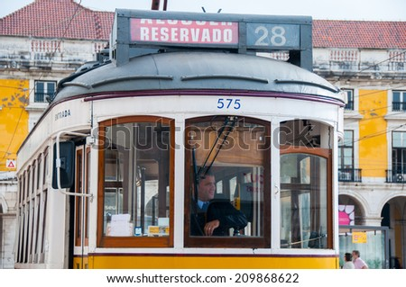 LISBON,PORTUGAL - OCT 25: Famous tram 28 at the Commerce square  on October 25, 2013 in Lisbon, Portugal. The Lisbon tramway network operates since 1873.