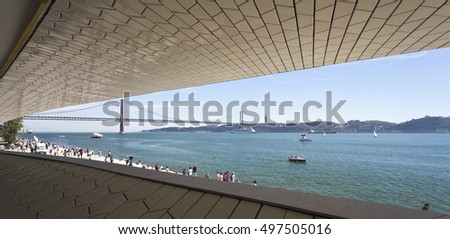 LISBON, PORTUGAL - October 5, 2016: View of the 25th of April Bridge seen from the new Museum of Art, Architecture and Technology in Lisbon, Portugal