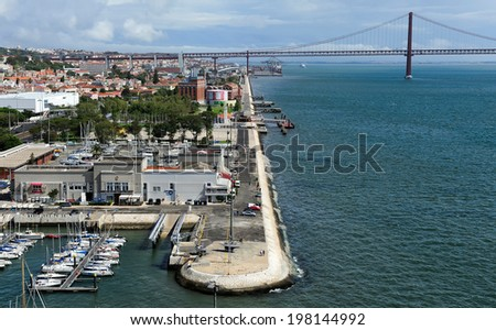 Lisbon, Portugal - September 27, 2013: view of waterfront and 25 de April Bridge from the top of the Monument to the Discoveries - stock photo