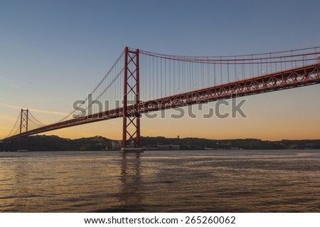 LISBON/PORTUGAL 4TH DECEMBER 2006 The Tagus River Bridge at Dawn - stock photo