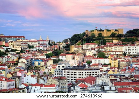 Lisbon, Portugal, view to the Alfama quarter and St. Jorge Castle at sunset - stock photo