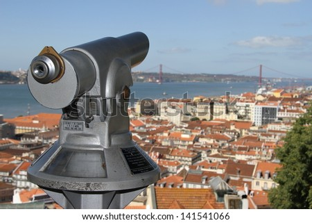 Lisbon, Portugal with bridge seen from the St. George's Castle with viewing scope - stock photo