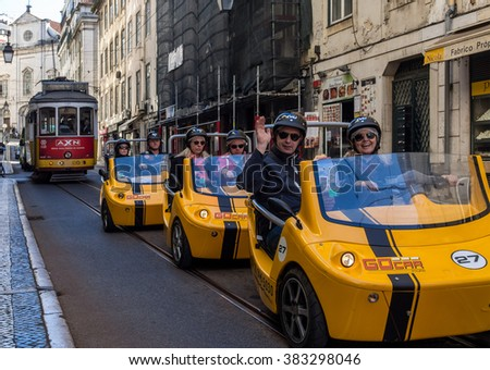 LISBON - 03/06/2015:  Tourists taking a City Tour in a  yellow GoCars