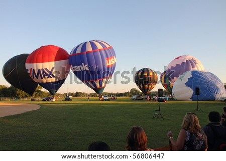 "LISLE, IL - JULY 3: Hot Air Balloons prepare for takeoff at the Annual Hot Air Balloon Festival ""Eyes to the Skies"" and for the celebration in the eve of Independence Day on July 3, 2010 in Lisle, IL"