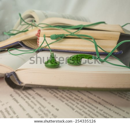 listen books background - green headphones - stock photo