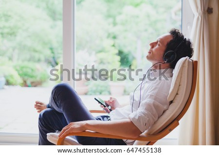 Listening Relaxing Music Home Relaxed Man Stock Photo ...